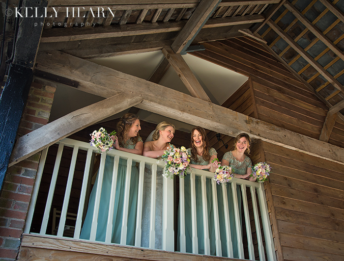 ASH_bridesmaids-over-balcony.jpg#asset:1