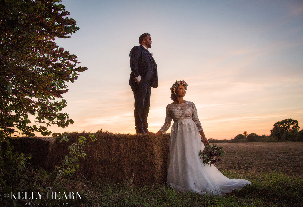 BOG_Couple-in-sunset-with-hay-bail.jpg#asset:2295