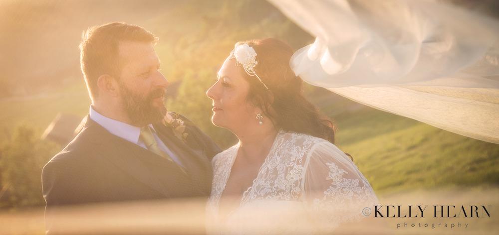 CAP_couple-through-veil-sunset.jpg#asset:2054