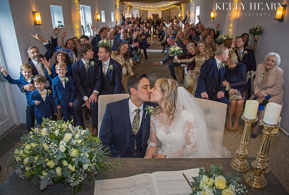 COL_register-signing-kiss.jpg#asset:2440