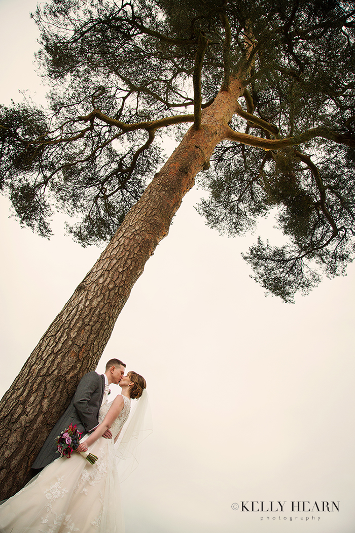 DOY_couple-by-tall-tree.jpg#asset:2072