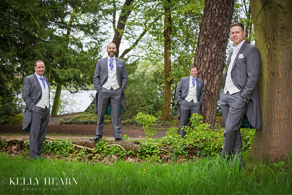 DOY_groom-groomsmen-leaning-against-trees.jpg#asset:2074
