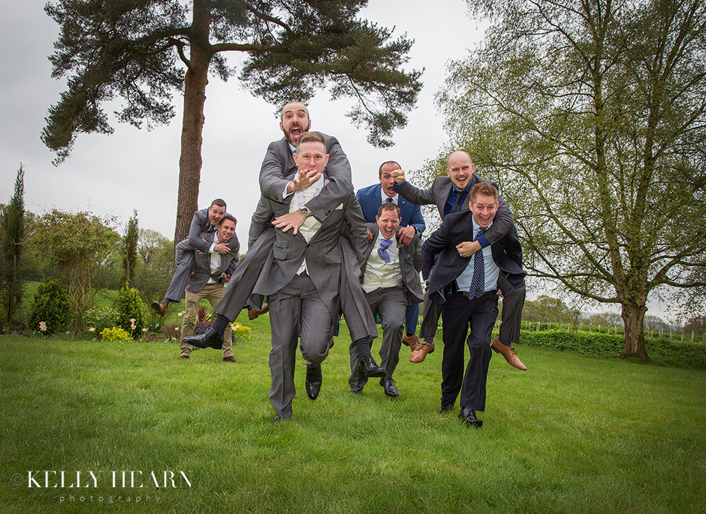 DOY_groom-piggybacks-with-groomsmen.jpg#asset:2075