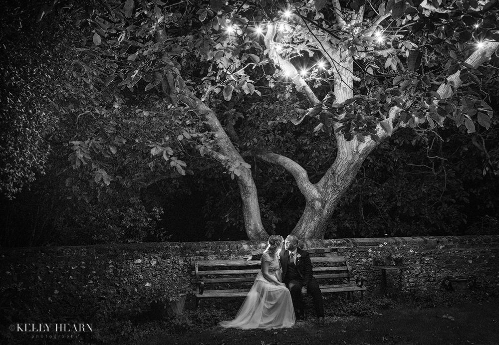 EDW_couple-on-bench-under-twinkling-tree.jpg#asset:1907
