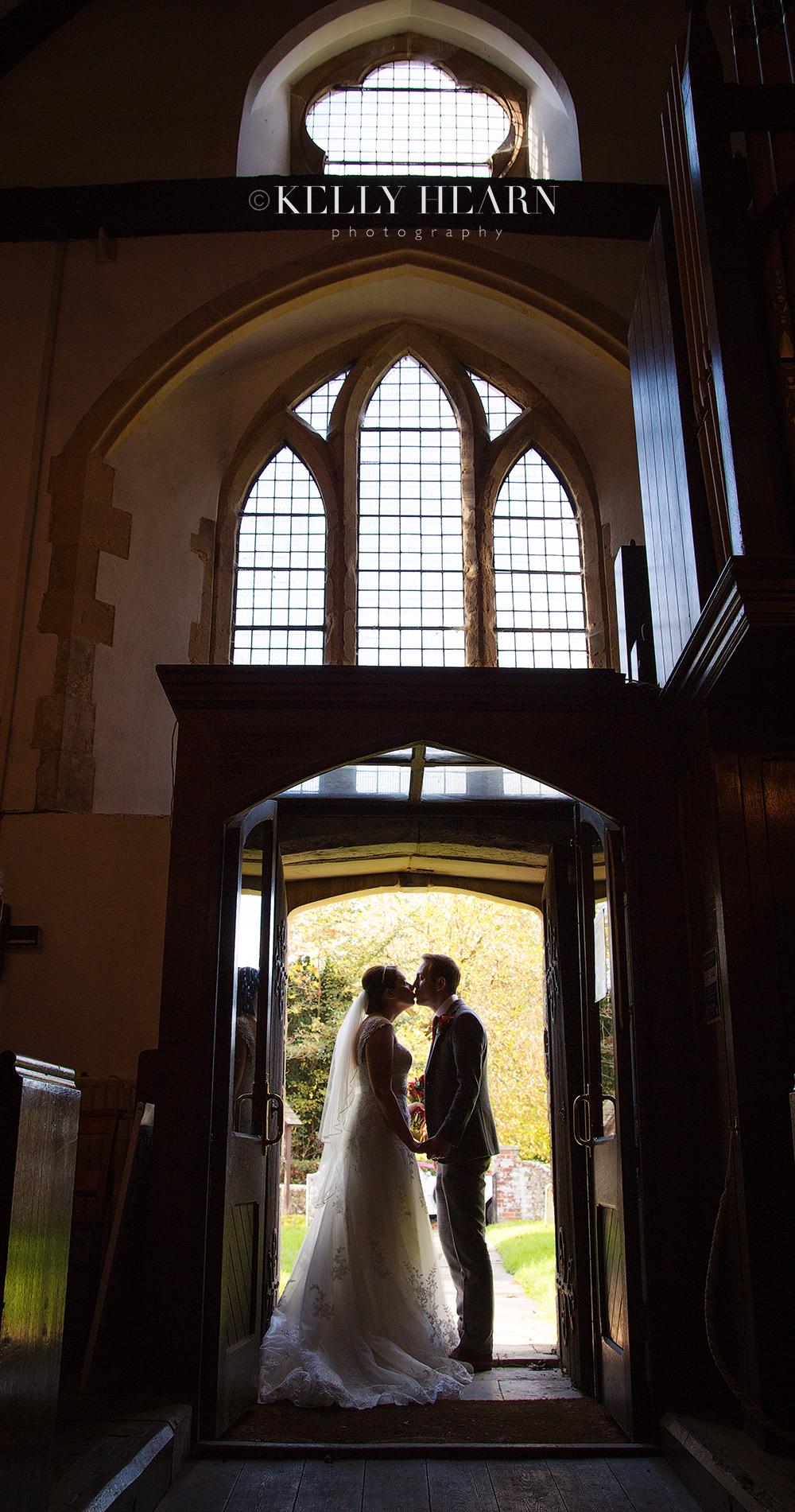 FAG_-Bride-and-groom-church-arch.jpg#asset:1842