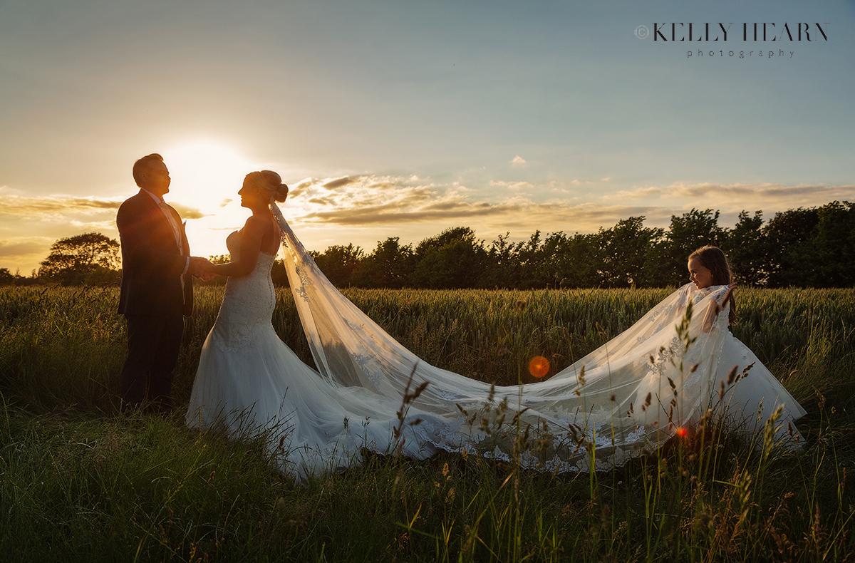FRE_bride-groom-daughter-sunset-veil.jpg#asset:3060