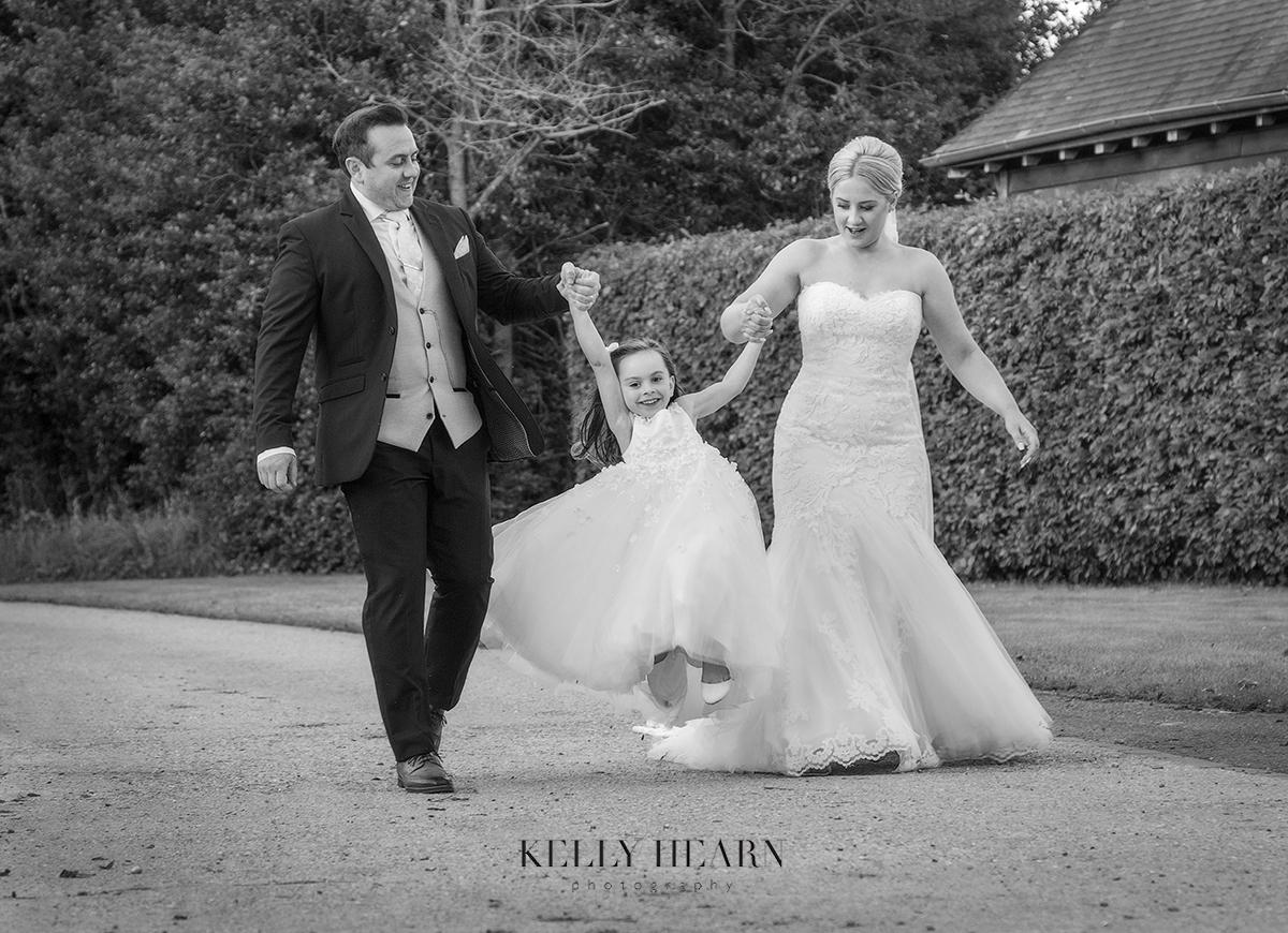 FRE_bride-groom-daughter-walk-skip.jpg#asset:3062