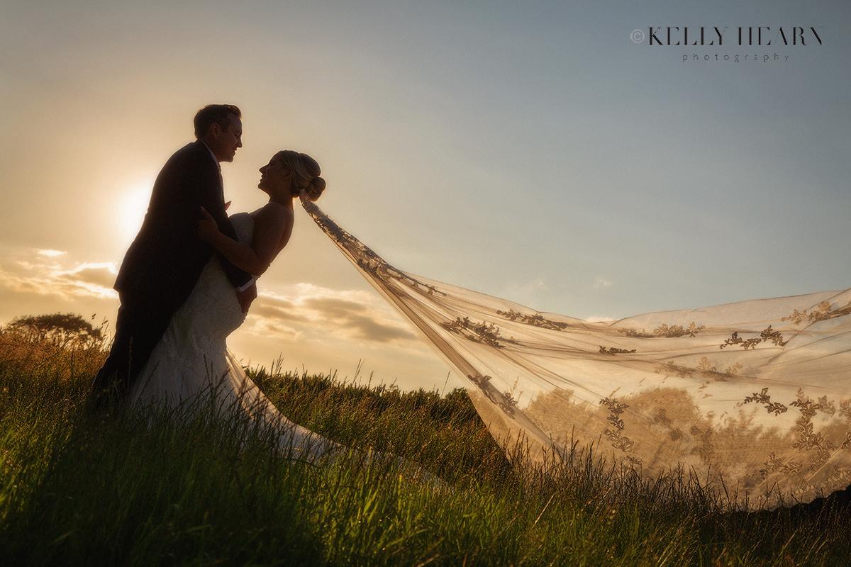 FRE_bride-groom-hugging-sunset.jpg#asset:3063