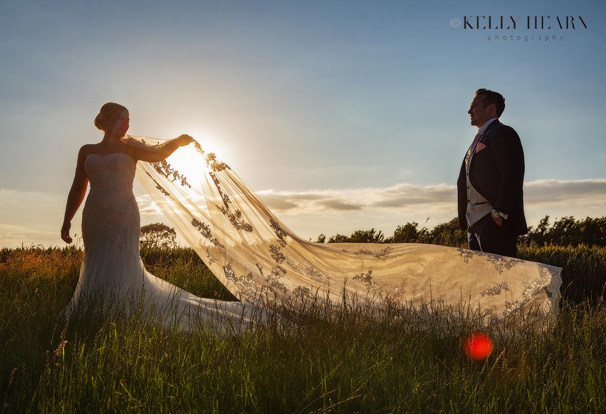 FRE_bride-groom-sunset-veil.jpg#asset:3065