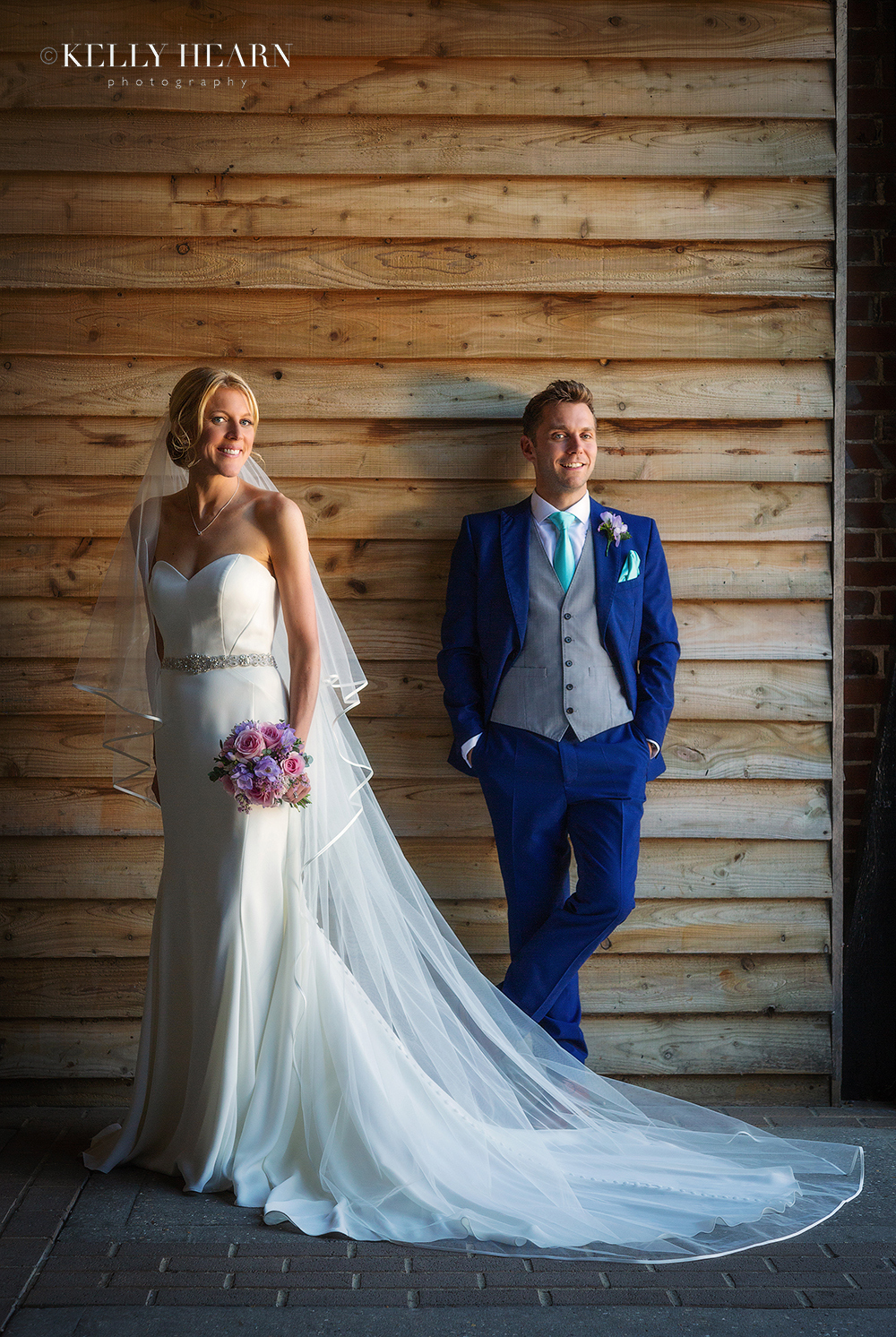 GRE_bride-and-groom-against-wooden-barn.jpg#asset:2696