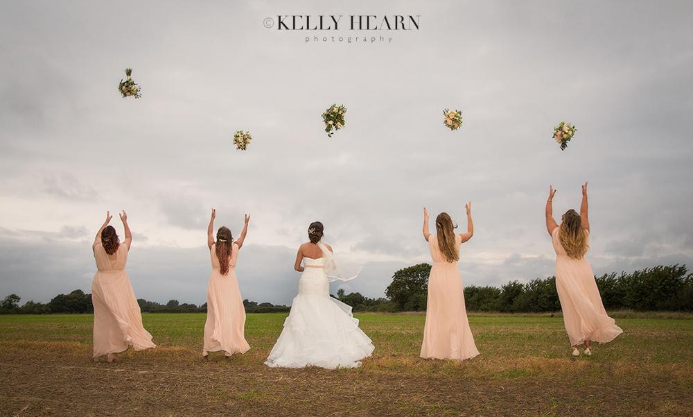 HAR_bride-bridesmaids-throw-bouquets.jpg#asset:1801
