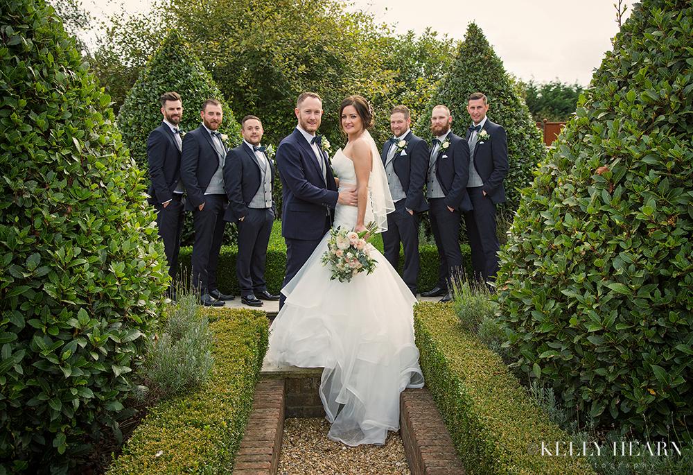 HAR_groomsmen-bride-garden.jpg#asset:1814