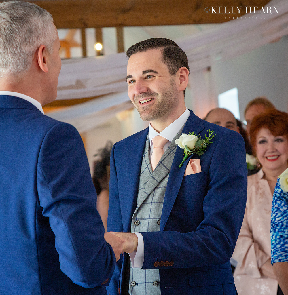 HAW_grooms-vows-holding-hands.jpg#asset:2559