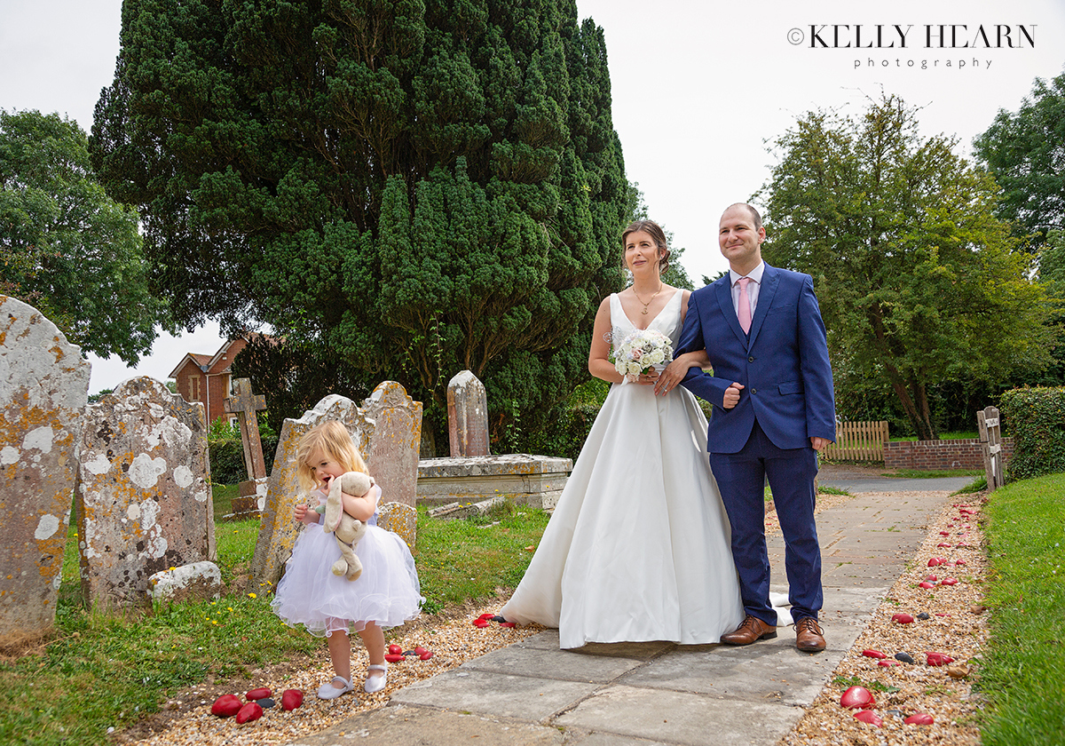 HIT_bride-escorted-in-churchyard.jpg#asset:2663