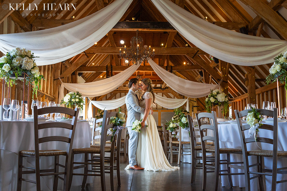 LEN_couple-in-reception-barn-with-drapes.jpg#asset:2580
