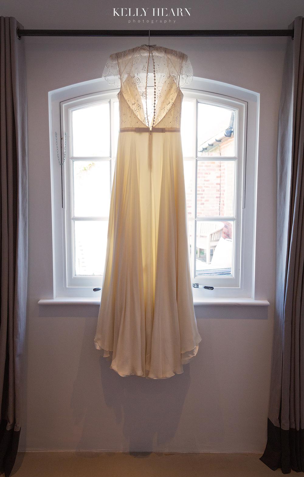 LEN_wedding-dress-hanging-at-window.jpg#asset:2586