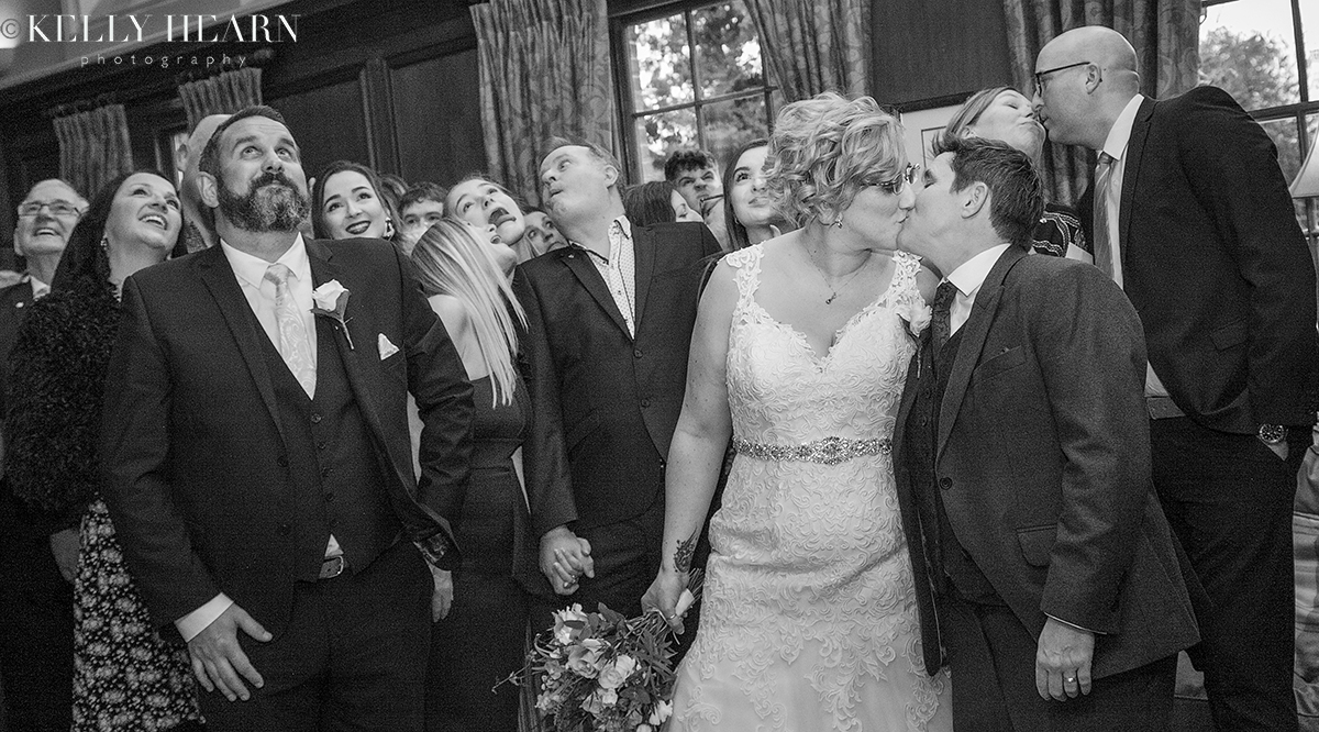LEW_brides-kiss-and-guests-black-and-white.jpg#asset:2776