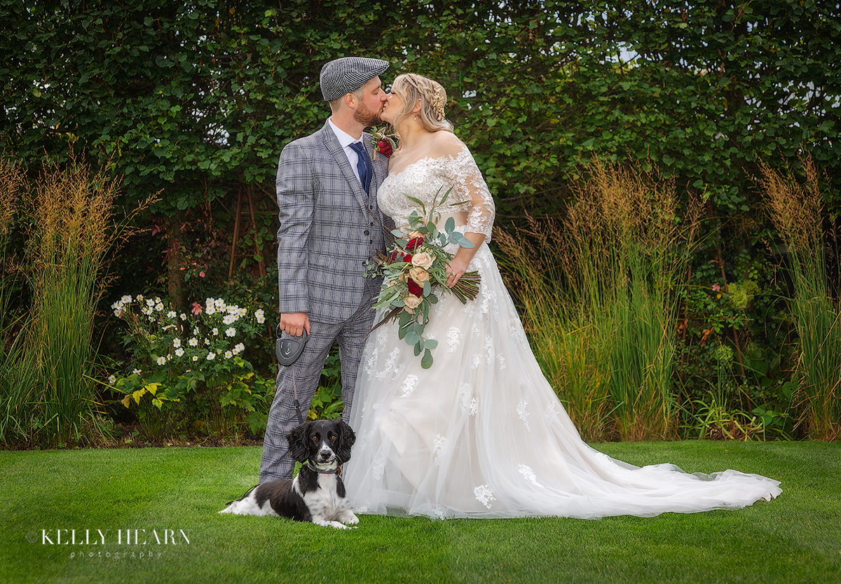 MAT_bride-groom-and-dog-on-lawn.jpg#asset:2752