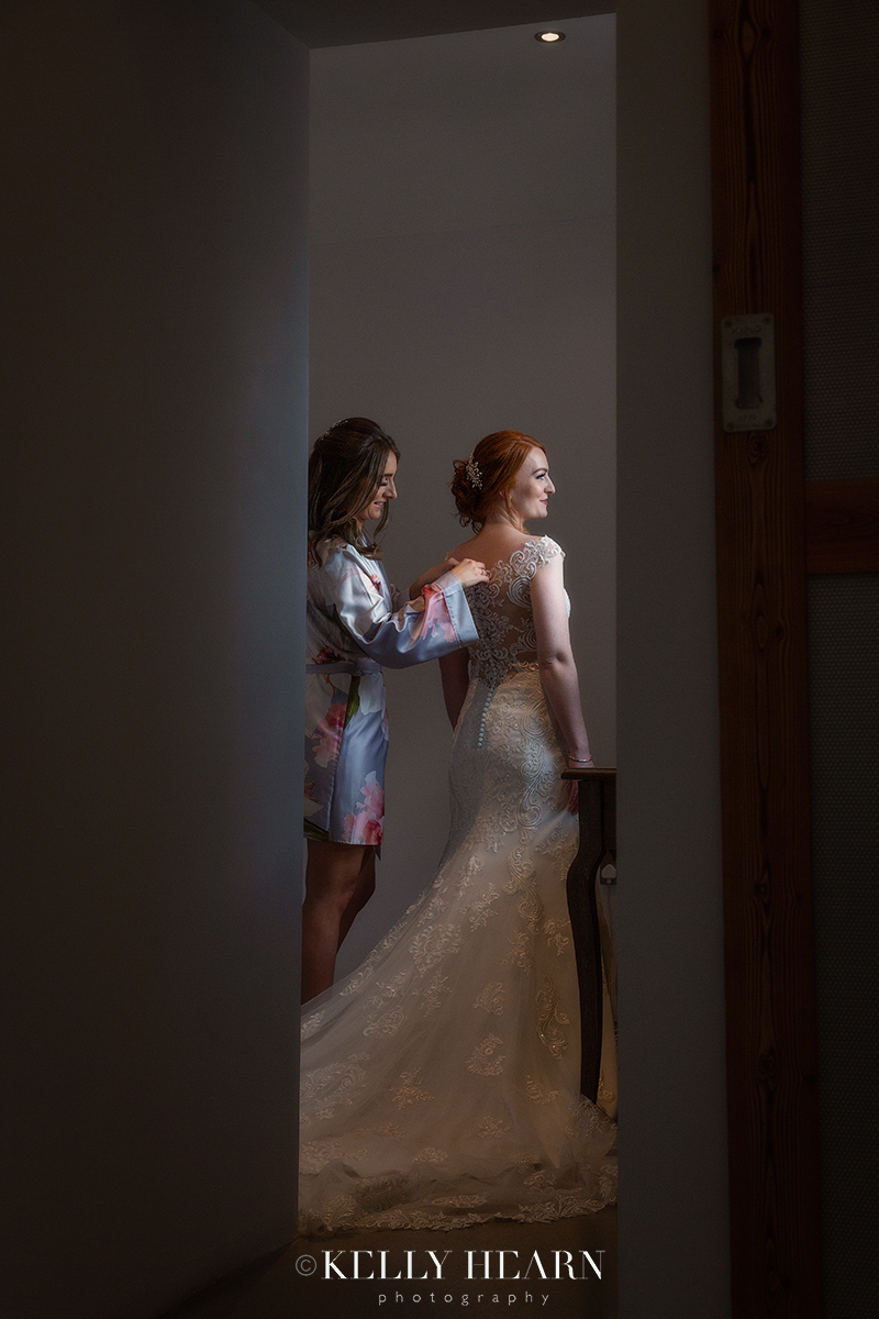 MOR_bride-getting-into-dress.jpg#asset:2539
