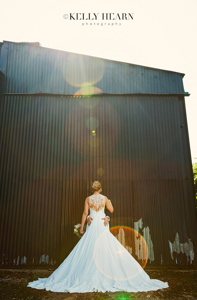 PAG_back-of-bride-barn-sun-flare.jpg#asset:2615