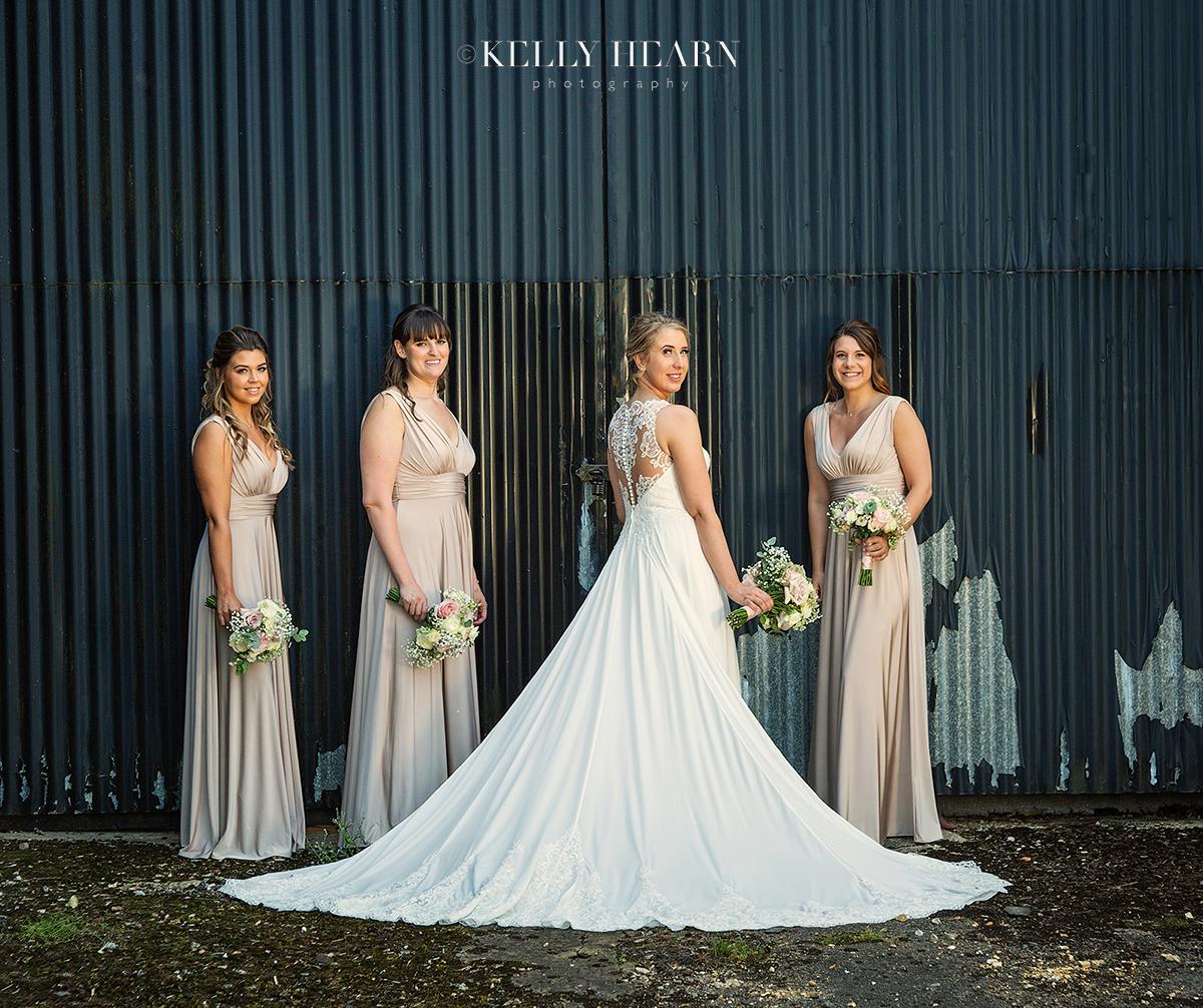 PAG_bride-bridesmaids-industrial-backdrop.jpg#asset:2621