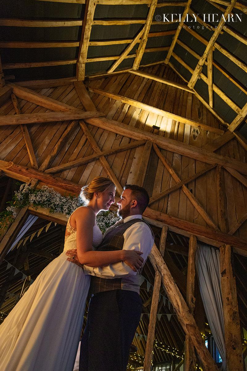 PAG_couple-embracing-inside-barn.jpg#asset:2626