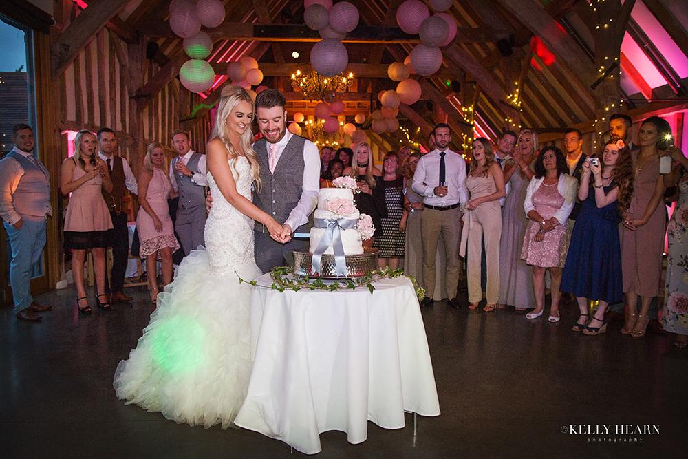PEARCE_couple-cutting-cake.jpg#asset:177