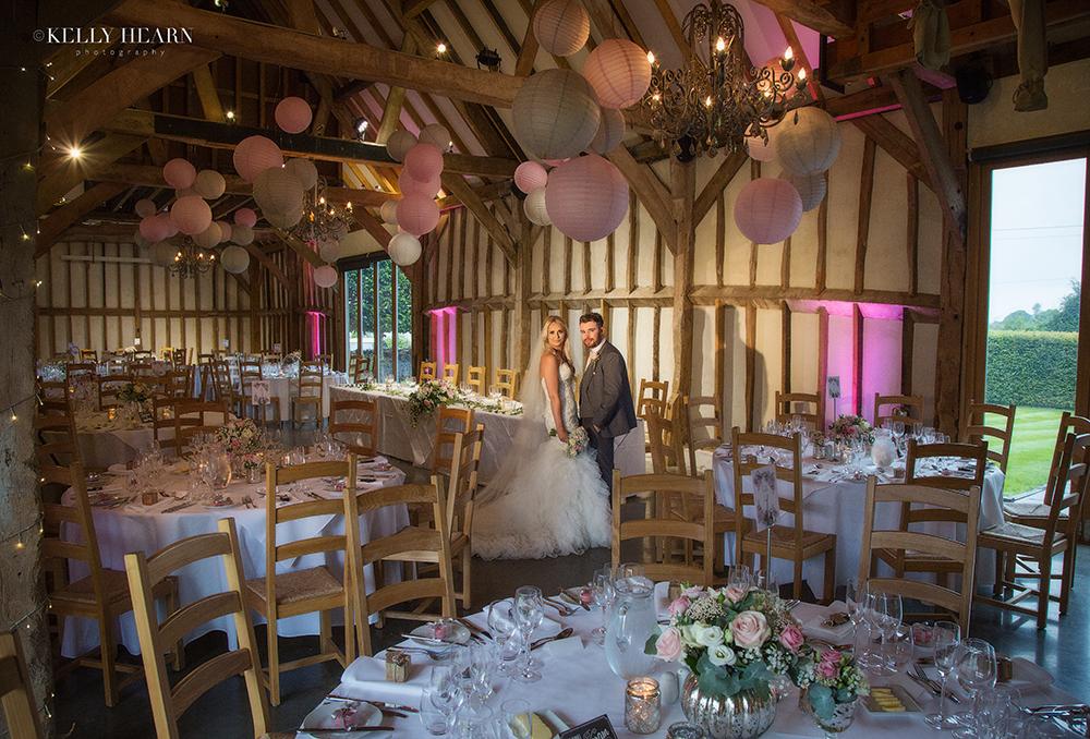 PEARCE_couple-in-reception-barn.jpg#asse