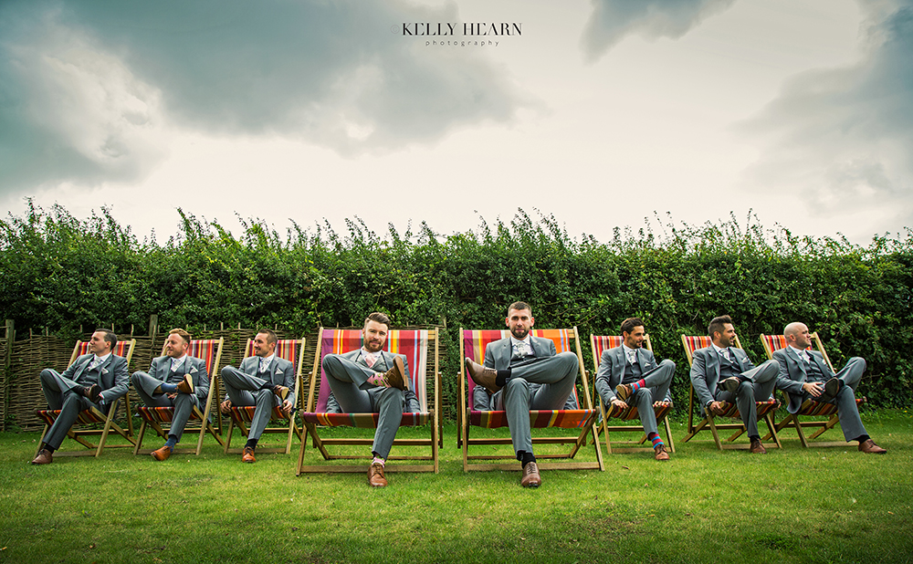 PEARCE_groomsmen-on-deckchairs.jpg#asset