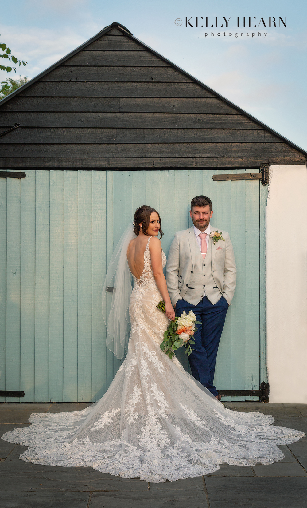 REE_bride-groom-barn-doors.jpg#asset:3047