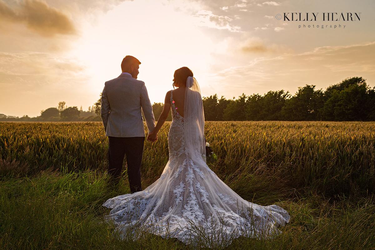 REE_bride-groom-sunset-field.jpg#asset:3050
