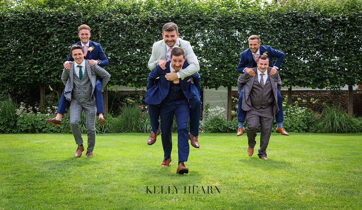 REE_groom-groomsmen-piggy-back.jpg#asset:3053