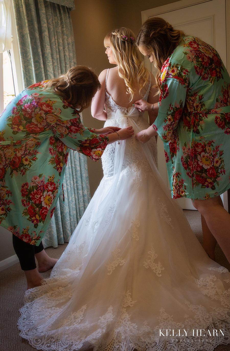 STAU_bride-putting-on-dress.jpg#asset:2498