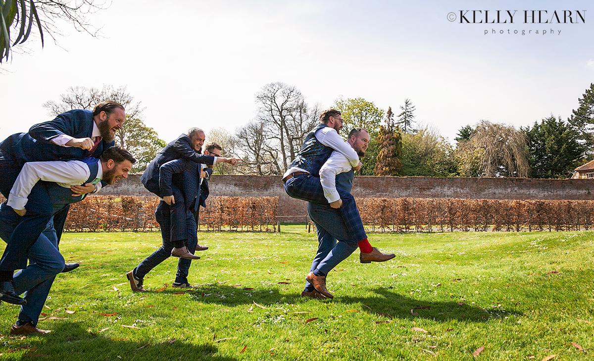 STAU_groom-groomsmen-piggybacks.jpg#asset:2502