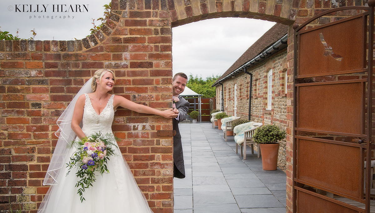 THO_bride-groom-holding-hands-under-archway.jpg#asset:2106