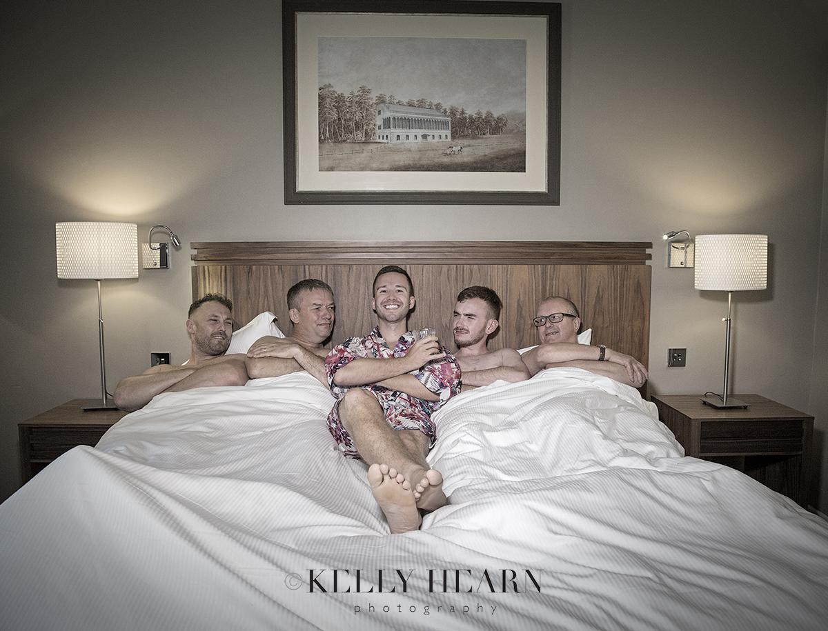 THO_groomsmen-in-bed.jpg#asset:2111