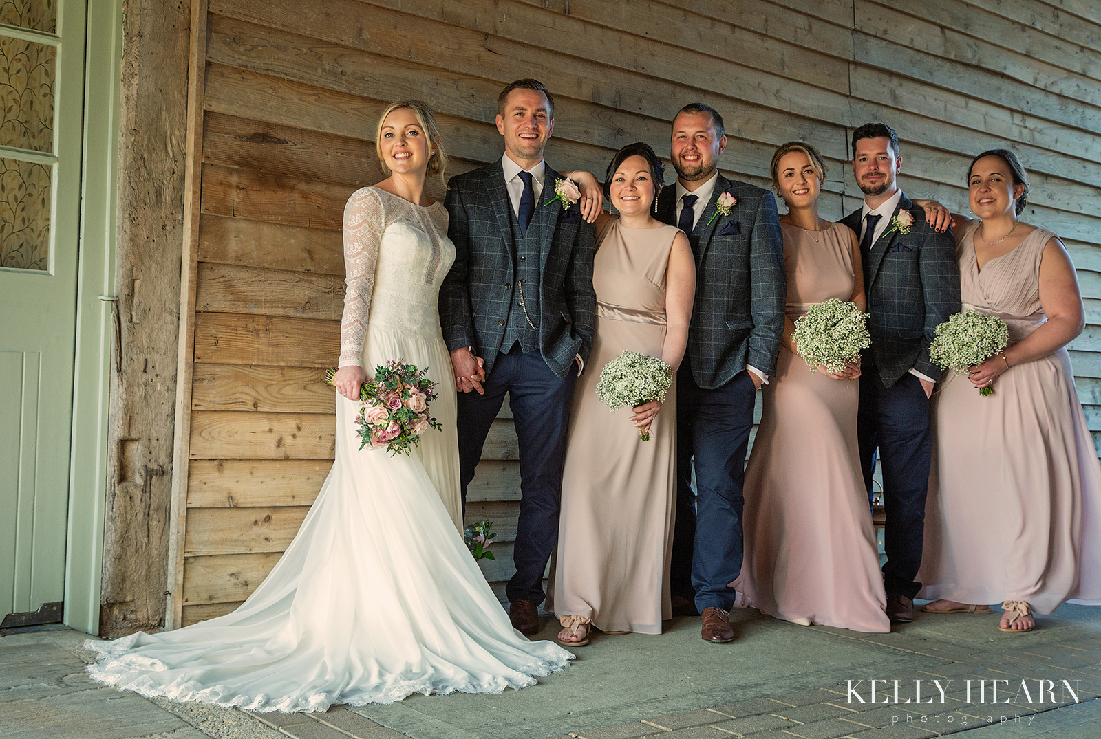 WALM_bridal-party-against-wooden-slats.jpg#asset:2476