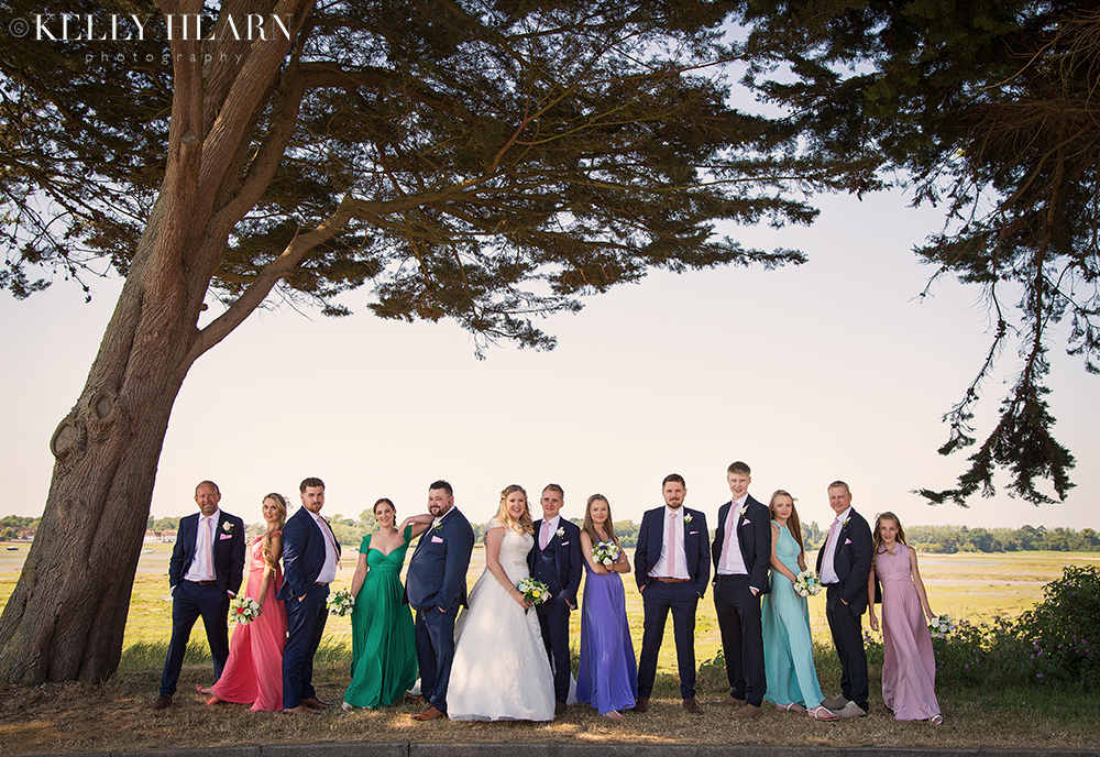 WEST_couple-bridal-party-under-trees.jpg#asset:2140