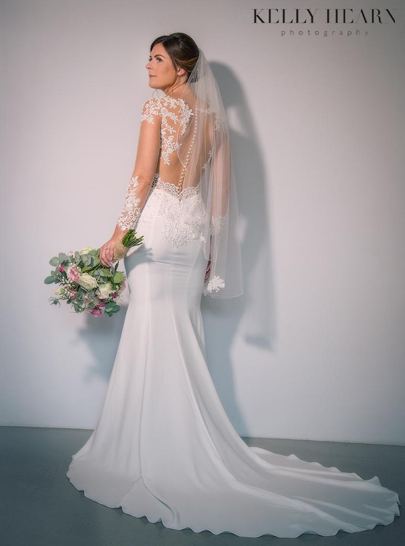 WHITE_bride-portrait-back-of-dress.jpg#asset:2235